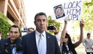FILE - In this July 1, 2019, file photo, U.S. Rep. Duncan Hunter, R-Calif., leaves federal court after a hearing in San Diego. Hunter, who is facing corruption charges, wants his Sept. 10 trial postponed while his attorneys appeal a judge's refusal a month earlier to dismiss the case. (AP Photo/Denis Poroy, File)