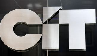FILE - This June 23, 2010, file photo shows a sign for CIT Group Inc. the commercial and consumer finance company in New York. CIT Group is buying Mutual of Omaha Bank for $1 billion to expand its commercial banking operations. (AP Photo/Mark Lennihan, File)