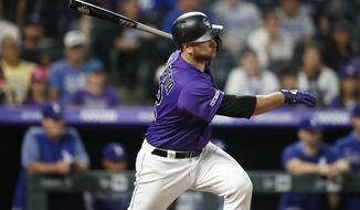 Colorado Rockies' Chris Iannetta watches his single off Los Angeles Dodgers' Tony Gonsolin during the ninth inning of a baseball game Tuesday, July 30, 2019, in Denver. The Dodgers won 9-4. (AP Photo/David Zalubowski)