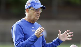 In this photo taken Friday, Aug. 2, 2019 Duke head coach David Cutcliffe directs his players during an NCAA college football practice in Durham, N.C. (AP Photo/Gerry Broome)