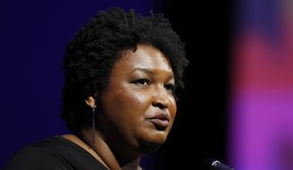 File- This July 22, 2019, file photo shows former Georgia House Minority Leader Stacey Abrams addressing the 110th NAACP National Convention,  in Detroit. Abrams is set to announce a multimillion-dollar initiative to staff and fund voter protection teams in battleground states across the country ahead of the 2020 elections. An aide familiar with the decision said she'll focus on the new program rather than run for president herself. The aide said Abrams would announce the initiative Tuesday, Aug. 13, 2019, during a speech before a labor union convention in Las Vegas.(AP Photo/Carlos Osorio, File)