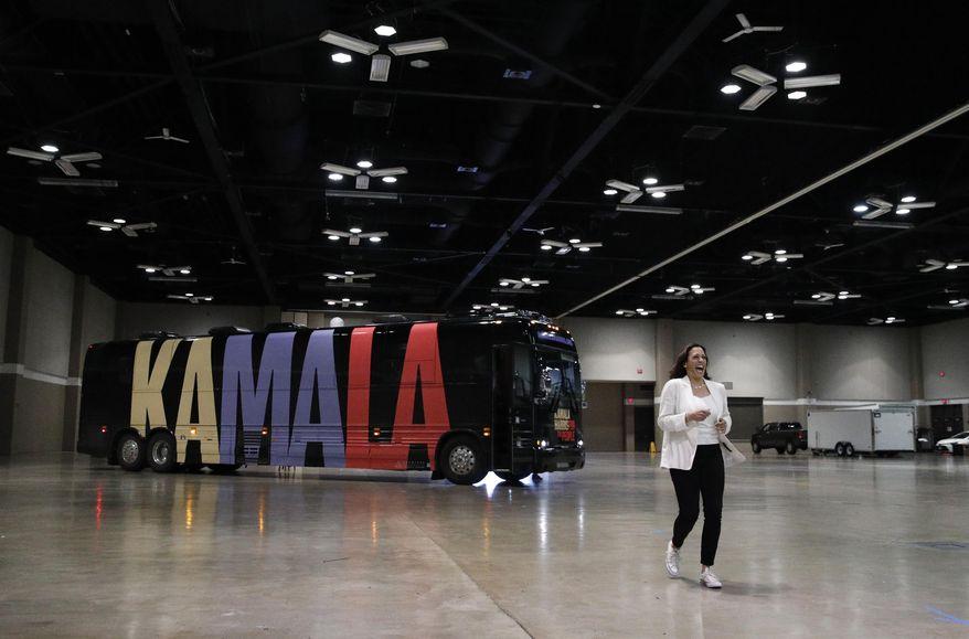Democratic presidential candidate Sen. Kamala Harris, D-Calif., enters a rally Monday, Aug. 12, 2019, in Davenport, Iowa. (AP Photo/John Locher)