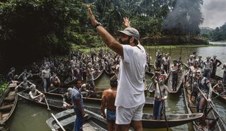 "This image provided by Zoetrope Corp. shows director Francis Ford Coppola on location directing a scene in ""Apocalypse Now Final Cut."" The movie releases in theaters on Aug. 15. (Chas Gerretsen/Nederlands Fotomuseum/Zoetrope Corp. via AP)"