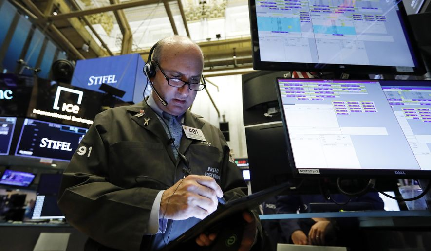 FILE - In this Aug. 6, 2019, file photo trader Andrew Silverman works on the floor of the New York Stock Exchange. The U.S. stock market opens at 9:30 a.m. EDT on Tuesday, Aug. 13. (AP Photo/Richard Drew, File)