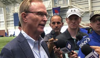 New York Giants co-owner John Mara talks to the media in East Rutherford, N.J., Tuesday, Aug. 13, 2019. (AP Photo/Tom Canavan)