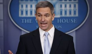Acting Director of United States Citizenship and Immigration Services Ken Cuccinelli, speaks during a briefing at the White House, Monday, Aug. 12, 2019, in Washington. (AP Photo/Evan Vucci)