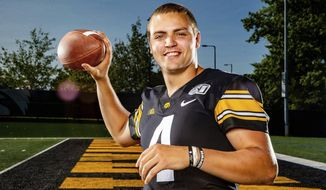 Iowa quarterback Nate Stanley poses for a photo during the team's NCAA college football media day, Friday, Aug. 9, 2019, in Iowa City, Iowa. (Zach Boyden-Holmes/The Des Moines Register via AP)
