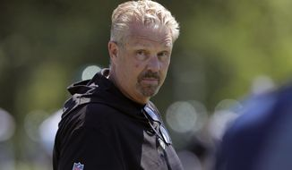 FILE - In this June 4, 2019, file photo, New York Jets defensive coordinator Gregg Williams looks on as his players run drills at the team's NFL football training facility in Florham Park, N.J. Gregg Williams has been described in many ways during his 30-year NFL coaching career _ several flattering, and others not exactly appropriate for young ears. But there's one adjective used by most anyone you ask, love him or hate him.Intense. (AP Photo/Julio Cortez, File)