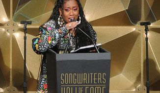 File-This June 13, 2019, file photo shows Missy Elliott speaking at the 50th annual Songwriters Hall of Fame induction and awards ceremony in New York. Elliott, one of the most iconic players in the history of music videos, will receive the Michael Jackson Video Vanguard Award at the 2019 MTV Video Music Awards. MTV announced Monday, Aug. 12, 2019, that Elliott will also perform on Aug. 26 at the Prudential Center in Newark, New Jersey. (Photo by Brad Barket/Invision/AP, File)