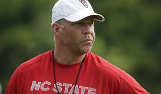This photo taken Tuesday, Aug. 6, 2019 shows North Carolina State head coach Dave Doeren during an NCAA college football practice in Raleigh, N.C. (AP Photo/Gerry Broome)