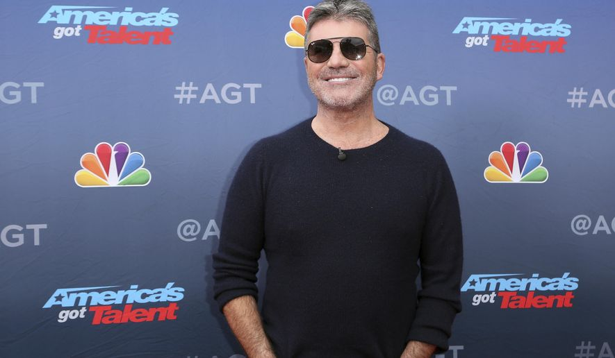 """FILE - In this March 11, 2019, file photo, Simon Cowell arrives at the """"America's Got Talent"""" Season 14 Kickoff at the Pasadena City Auditorium in Pasadena, Calif. In a week dominated by competition shows, """"America's Got Talent"""" dominated the ratings competition. The Nielsen company says NBC's variety showcase brought in 9.7 million viewers last week. The show chose the singers, comedians, dancers and beatboxers that will be on its season-ending live episodes. (Photo by Willy Sanjuan/Invision/AP, File)"""