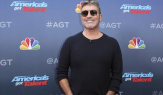 "FILE - In this March 11, 2019, file photo, Simon Cowell arrives at the ""America's Got Talent"" Season 14 Kickoff at the Pasadena City Auditorium in Pasadena, Calif. In a week dominated by competition shows, ""America's Got Talent"" dominated the ratings competition. The Nielsen company says NBC's variety showcase brought in 9.7 million viewers last week. The show chose the singers, comedians, dancers and beatboxers that will be on its season-ending live episodes. (Photo by Willy Sanjuan/Invision/AP, File)"