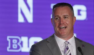 FILE - In this July 19, 2019, file photo, Northwestern head coach Pat Fitzgerald responds to a question during the Big Ten Conference NCAA college football media days in Chicago. Coming off a 9-5 season, which included a Big Ten West title, Northwestern is poised for another solid season, but must find a replacement for four-year starter Clayton Thorson at quarterback. Clemson transfer Hunter Johnson, TJ Green and Aidan Smith are the main contenders. (AP Photo/Charles Rex Arbogast, File)