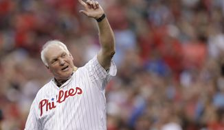 FILE - In this Aug. 12, 2017, file photo, Philadelphia Phillies' Charlie Manuel waves to the crowd before a baseball game against the New York Mets in Philadelphia. The Phillies have hired former manager Charlie Manuel to replace John Mallee as hitting coach. Manuel was working as senior adviser to the general manager. The Phillies announced Tuesday, Aug. 13, 2019,  that he would assume his new position for the remainder of the season. (AP Photo/Matt Slocum, File)