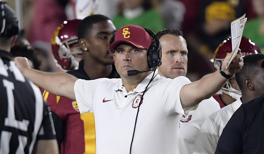 FILE - In this Nov. 24, 2018, file photo, Southern California head coach Clay Helton gestures during the first half of an NCAA college football game against Notre Dame in Los Angeles. Helton went 21-6 with a Rose Bowl victory and Pac-12 title in his first two full seasons as USC coach, but his job status is one of the stories of the 2019 season. (AP Photo/Mark J. Terrill, File)
