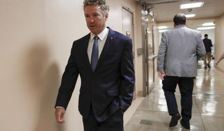 FILE - In this Wednesday, July 31, 2019, file photo, Sen. Rand Paul, R-Ky., walks to the Senate chamber at the Capitol in Washington. Paul is easing back into public activities after his recent lung surgery sidelined him for part of the August congressional break. (AP Photo/J. Scott Applewhite, File)