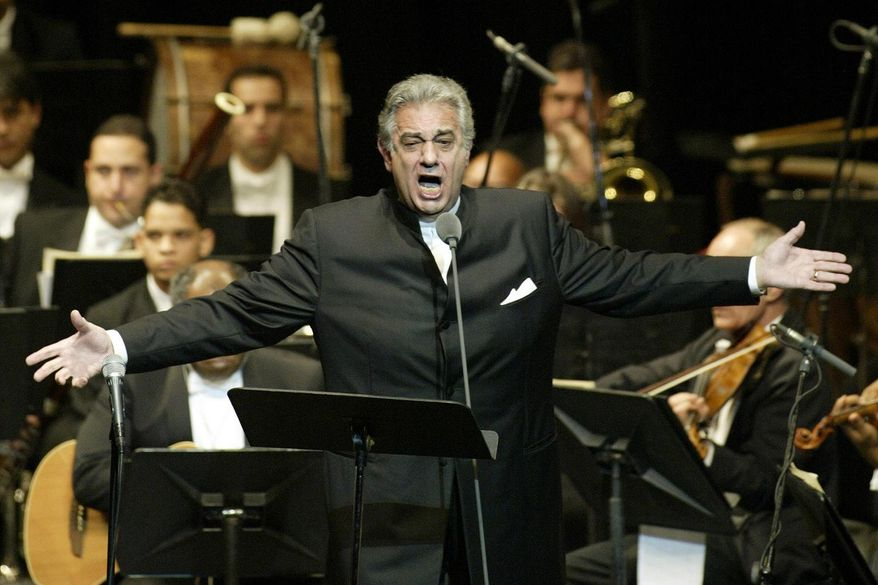 In this Thursday, Jan. 22, 2004, file photo, Placido Domingo sings during his performance at the National Theater in Santiago, Dominican Republic. Nine women in the opera world have told The Associated Press that Domingo, one of the most celebrated and powerful men in the industry, tried to pressure them into sexual relationships and sometimes punished women professionally when they refused his advances. (AP Photo/Miguel Gomez, File)