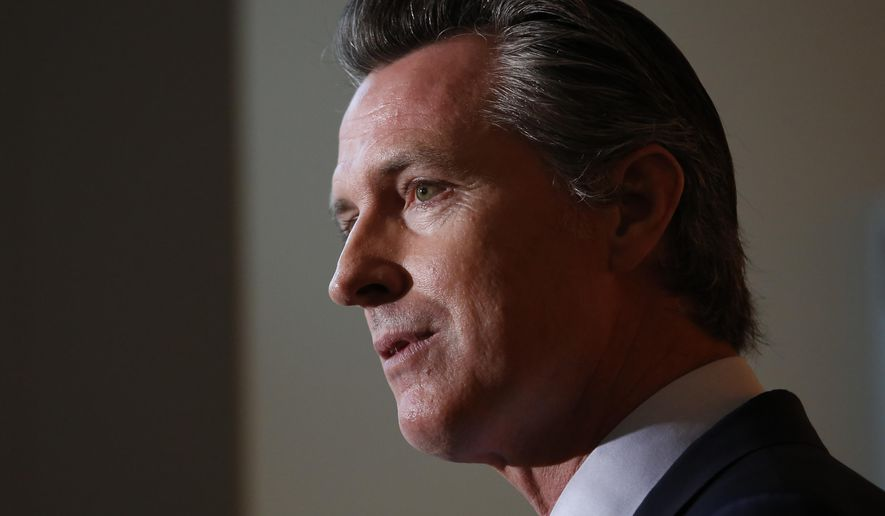 California Gov. Gavin Newsom answers questions regarding the lawsuit the state has joined in with 21 other Democrat-led states against the Trump administration over its decision to ease restrictions on coal-fired power plants, during a news conference in Sacramento, Calif., Tuesday Aug. 13, 2019.  The lawsuit, filed in the U.S. Court of Appeals for the District of Columbia Circuit, says the new rule violates the federal Clean Air Act because it does not meaningfully replace power plants' greenhouse gas emissions. (AP Photo/Rich Pedroncelli)