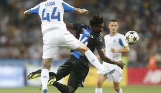 Brugge's David Okereke, right, and Dynamo Kiev's Tamas Kadar challenge for the ball during the Champions League third qualifying round, second leg, soccer match between Dynamo Kyiv and Club Brugge at the Olympiyskiy stadium in Kiev, Ukraine, Tuesday, Aug. 13, 2019. (AP Photo/Efrem Lukatsky)