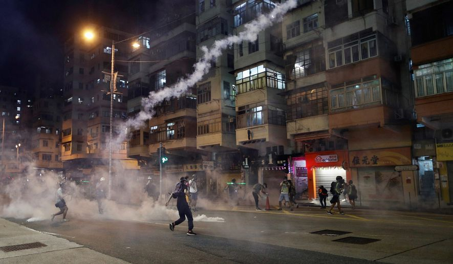 "Protesters in Hong Kong have been pressuring Beijing to abide by its promised ""one country, two systems"" policy that allowed a democratic system to operate. (Associated Press)"