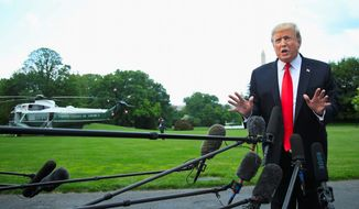 President Trump faces a horde of reporters before leaving for a rally. A survey says voters are divided on if he's being covered fairly. (Associated Press)