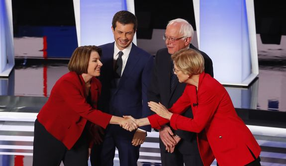 Sen. Amy Klobuchar, D-Minn., from left, South Bend Mayor Pete Buttigieg, Sen. Bernie Sanders, I-Vt., and Sen. Elizabeth Warren, D-Mass., greet each other before the first of two Democratic presidential primary debates hosted by CNN Tuesday, July 30, 2019, in the Fox Theatre in Detroit. (AP Photo/Paul Sancya) ** FILE **