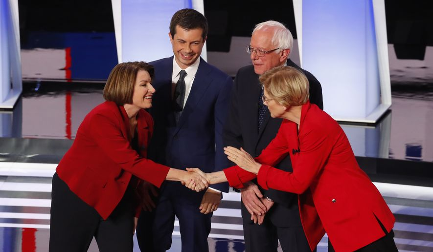 Sen. Amy Klobuchar, D-Minn., from left, South Bend Mayor Pete Buttigieg, Sen. Bernie Sanders, I-Vt., and Sen. Elizabeth Warren, D-Mass., greet each other before the first of two Democratic presidential primary debates hosted by CNN Tuesday, July 30, 2019, in the Fox Theatre in Detroit. (AP Photo/Paul Sancya)