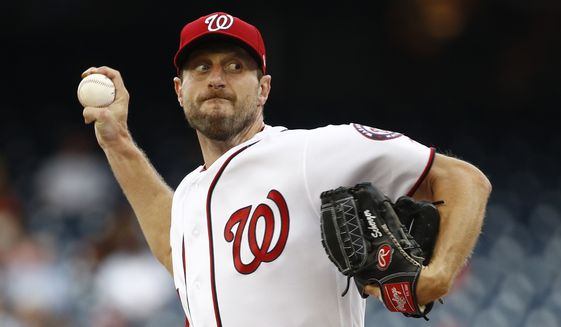 FILE - In this July 25, 2019, file photo, Washington Nationals starting pitcher Max Scherzer throws to the Colorado Rockies during a baseball game in Washington. Three-time Cy Young Award winner Max Scherzer says he is ready to get in a game for the Washington Nationals and come off the injured list. Scherzer played catch at Nationals Park on Wednesday, Aug. 14. a day after throwing the equivalent of about two innings in a simulated game, and said he felt able to return to action from a back muscle problem. (AP Photo/Patrick Semansky) ** FILE **