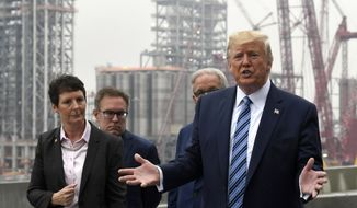 President Donald Trump speaks as he views construction during a visit to Shell's soon-to-be completed Pennsylvania Petrochemicals Complex on Tuesday, Aug. 13, 2019, in Monaca, Pa. At left is Hilary Mercer, vice president of Shell Pennsylvania Chemicals, left, and second from left is Environmental Protection Agency administrator Andrew Wheeler and Charles Holliday, chairman of the board of directors for Royal Dutch Shell. (AP Photo/Susan Walsh)