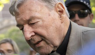 FILE - In this Feb. 27, 2019, file photo, Cardinal George Pell arrives at the County Court in Melbourne, Australia. An Australian court will announce its verdict next week on the appeal of the most senior Catholic clergyman to be found guilty of child sex abuse. (AP Photo/Andy Brownbill, File)