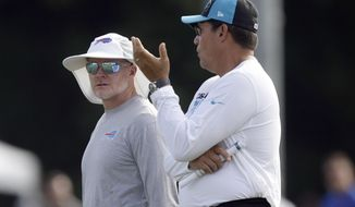 Buffalo Bills coach Sean McDermott, left, and Carolina Panthers coach Ron Rivera chat during an NFL football training camp in Spartanburg, S.C., Wednesday, Aug. 14, 2019. (AP Photo/Gerry Broome)