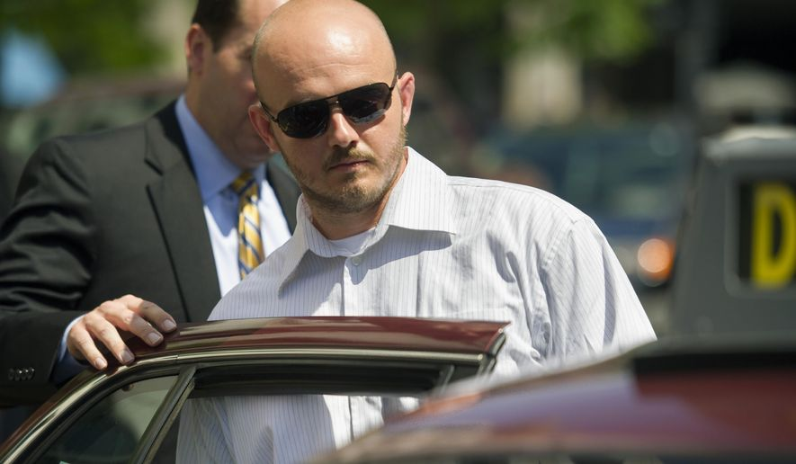 In this June 11, 2014, file photo, former Blackwater Worldwide guard Nicholas Slatten enters a taxi cab as he leaves federal court in Washington, after the start of his trial. A federal judge has sentenced a former Blackwater security contractor to life in prison for his role in the 2007 shooting of unarmed civilians in Iraq. (AP Photo/Cliff Owen, File)