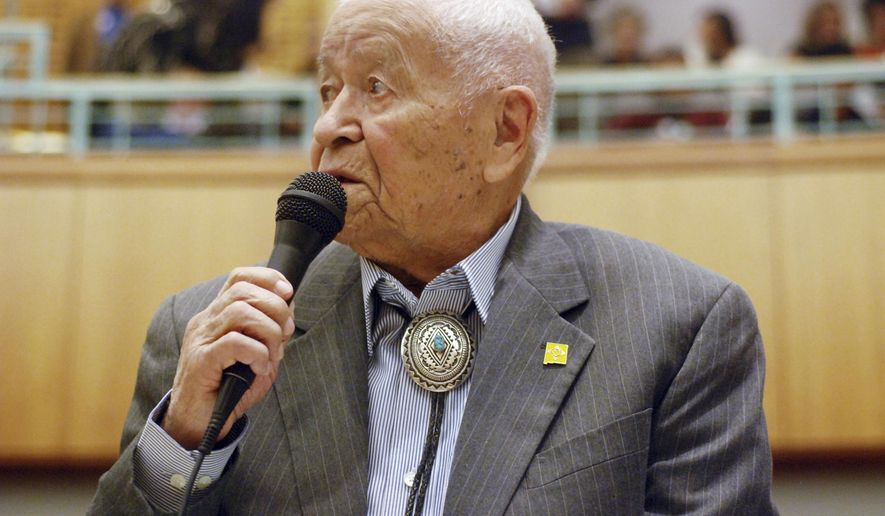 FILE - In this Feb. 2, 2018 file photo, Democratic New Mexico state Sen. John Pinto talks about his career as a lawmaker on American Indian Day in the Legislature on in Santa Fe, N.M. Some Navajo Nation officials are seeking to ask New Mexico to rename a U.S. highway after Pinto who died in May 2019 after four decades as a lawmaker. (AP Photo/Morgan Lee, File)