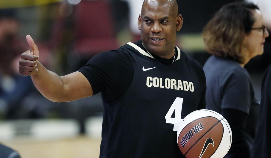 """FILE - In this Thursday, March 7, 2019, file photograph, Colorado head football coach Mel Tucker gestures to fans in the first half of an NCAA college basketball game as Colorado hosts UCLA in Boulder, Colo. Colorado's new head coach isn't cutting the Buffaloes any slack in his first season in Boulder, proclaiming, """"We have high expectations right now.""""  (AP Photo/David Zalubowski, File)"""