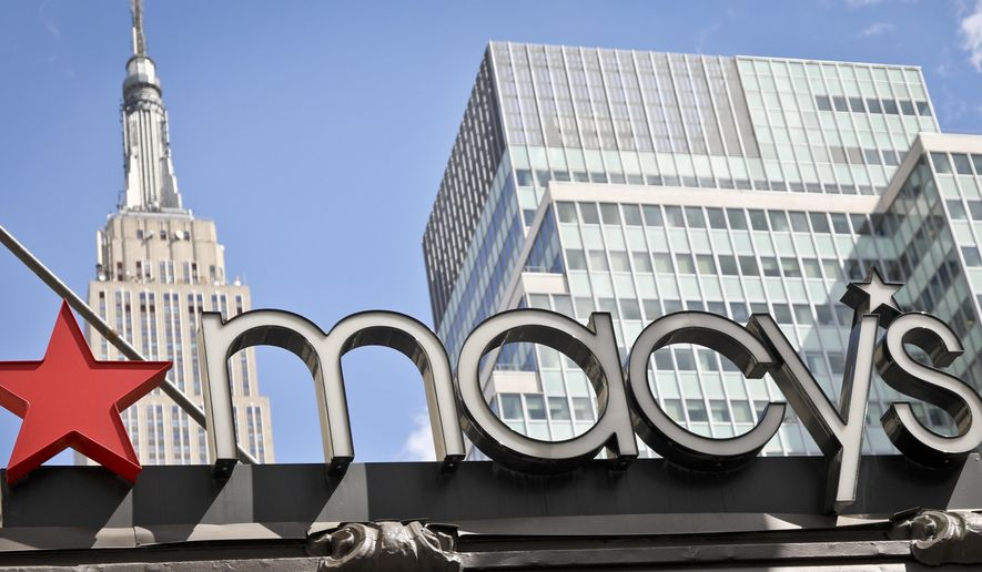 This May 2, 2017, file photo shows corporate signage at Macy's flagship store in New York. (AP Photo/Bebeto Matthews, File)