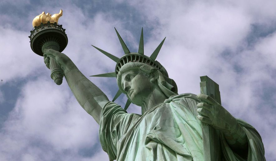 In this June 2, 2009, file photo, the Statue of Liberty stands in New York harbor. (AP Photo/Richard Drew, File)