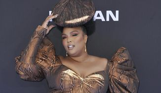 """FILE - In this June 23, 2019 file photo, Lizzo arrives at the BET Awards at the Microsoft Theater in Los Angeles. Lizzo's breakthrough hit """"Truth Hurts"""" is a two-year-old song, but it still has a chance at the 2020 Grammys.  """"Truth Hurts,"""" which was released in 2017, qualifies for the 2020 Grammys because the song was never submitted for contention in the Grammys process and it appears on an album released during the eligibility period for the upcoming show. (Photo by Richard Shotwell/Invision/AP, File)"""