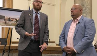 Colorado Democratic state Rep. Jonathan Singer of Longmont, left, and Joe Salazar, director of Colorado Rising, speak at a news conference in Denver on Wednesday, Aug. 14, 2019. Salazar's group is asking a state court to reinstate the city of Longmont's ban on hydraulic fracturing within the city limits. Longmont voters approved the ban 2012 but the state Supreme Court overturned it in 2016, saying only the state could regulate the industry under laws in force at the time. (AP Photo/Dan Elliott)