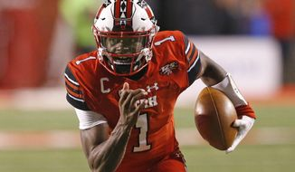 FILE - In this Oct. 12, 2018, file photo, Utah quarterback Tyler Huntley (1) carries the ball against Arizona during the first half of an NCAA college football game, in Salt Lake City. The Utes return quarterback Tyler Huntley, who threw for 1,788 yards with 12 touchdowns last season but missed the final five games because of a broken collarbone. (AP Photo/Rick Bowmer, File)