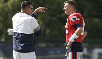 Tennessee Titans head coach Mike Vrabel talks with New England Patriots quarterback Tom Brady during a combined NFL football training camp Wednesday, Aug. 14, 2019, in Nashville, Tenn. Vrabel and Brady were teammates when Vrabel played for the Patriots. (AP Photo/Mark Humphrey)