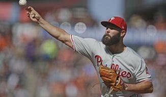 Philadelphia Phillies pitcher Jake Arrieta works against the San Francisco Giants in the first inning of a baseball game Sunday, Aug. 11, 2019, in San Francisco. (AP Photo/Ben Margot)
