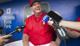 Philadelphia Phillies hitting coach Charlie Manuel discusses his new role in the dugout before a baseball game against the Chicago Cubs, Wednesday, Aug. 14, 2019 at Citizens Bank Park in Philadelphia. (Charles Fox/The Philadelphia Inquirer via AP)