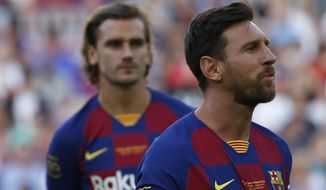 Barcelona forward Lionel Messi, right, looks on next to his teammate Antoine Griezman prior of the Joan Gamper trophy soccer match between FC Barcelona and Arsenal at the Camp Nou stadium in Barcelona, Spain, Sunday, Aug. 4, 2019. (AP Photo/Joan Monfort)