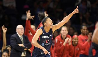 Washington Mystics forward Aerial Powers reacts during the first half of the team's WNBA basketball game against the Seattle Storm, Wednesday, Aug. 14, 2019, in Washington. (AP Photo/Nick Wass)