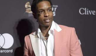 """FILE - This Feb. 9, 2019 file photo shows A$AP Rocky at Pre-Grammy Gala And Salute To Industry Icons in Beverly Hills, Calif. A Swedish court on Wednesday Aug. 14, 2019 found American rapper A$AP Rocky guilty of assault for his role in a June 30 street brawl in Stockholm says he and his two bodyguards """"assaulted the victim by hitting and kicking him as he lay on the ground.""""(Photo by Richard Shotwell/Invision/AP, File)"""