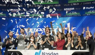 FILE - In this Jan. 16, 2018 file photo, Adam Neumann, center, co-founder and CEO of WeWork, attends the opening bell ceremony at Nasdaq in New York.  Office space-sharing company WeWork is getting ready to go public, adding to a growing list of tech businesses making such a move this year. WeWork, which recently renamed itself The We Co., said in a regulatory filing Wednesday, Aug. 14, 2019 that it now has 527,000 memberships across 29 countries.  (AP Photo/Mark Lennihan, File )