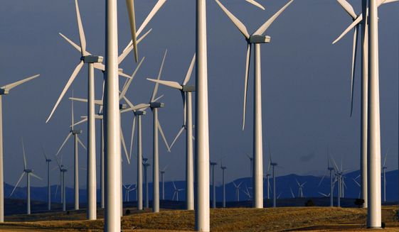 FILE - This May 6, 2013 file photo shows a wind turbine farm owned by PacifiCorp near Glenrock, Wyo. Bigger, more efficient equipment will allow a western U.S. electric utility to redevelop an aging Wyoming wind farm with far fewer turbines while generating the same amount of power. Portland, Oregon-based PacifiCorp plans to replace 68 wind turbines at the Foote Creek I wind farm with 13 turbines over the next year. (AP Photo/Matt Young)
