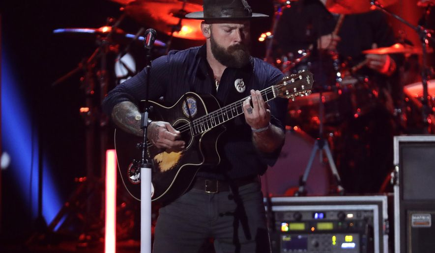 FILE - In this Wednesday, June 5, 2019 file photo Zac Brown performs at the CMT Music Awards in Nashville, Tenn. Brown has lost a bid to limit public access to his property in Alaska. Brown had asked the Kenai Peninsula Borough Planning Commission to remove easements the access along his property in hills above Homer, a small city on Kachemak Bay on Alaska's Kenai Peninsula. (AP Photo/Mark Humphrey,File)