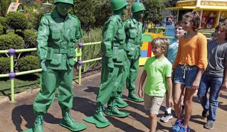 In this Saturday, June 23, 2018 photo, Green Army men interact with guests at Toy Story Land in Disney's Hollywood Studios at Walt Disney World in Lake Buena Vista, Fla. (AP Photo/John Raoux)