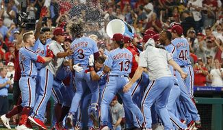 Philadelphia Phillies' Bryce Harper (3) celebrates his grand slam with teammates during the ninth inning of a baseball game against the Chicago Cubs, Thursday, Aug. 15, 2019, in Philadelphia. The Phillies won 7-5. (AP Photo/Chris Szagola)